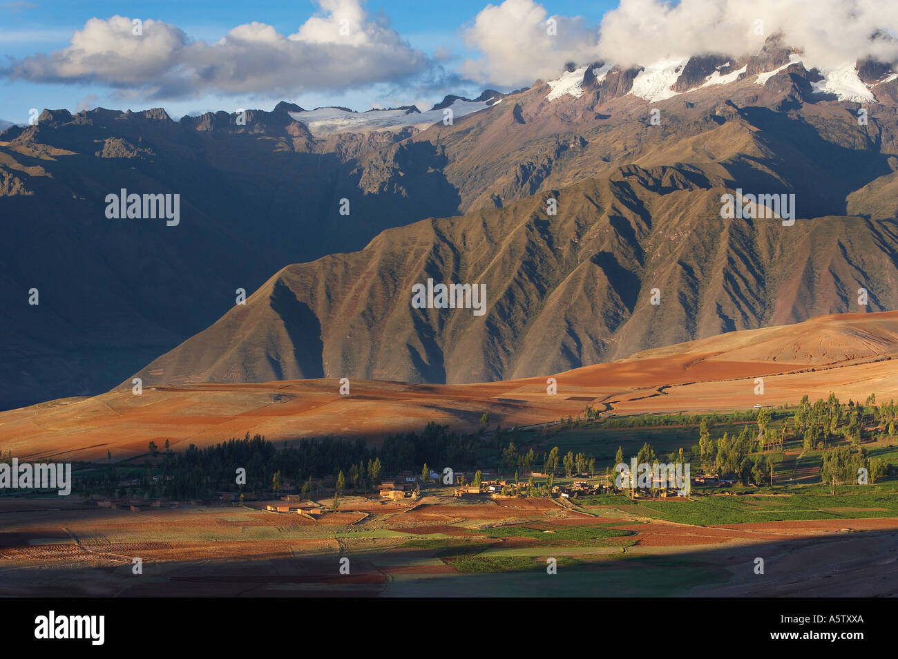 farmland above the Sacred Valley with the Urubamba Cordillera of the Andes nr Cusco Peru - Stock Image