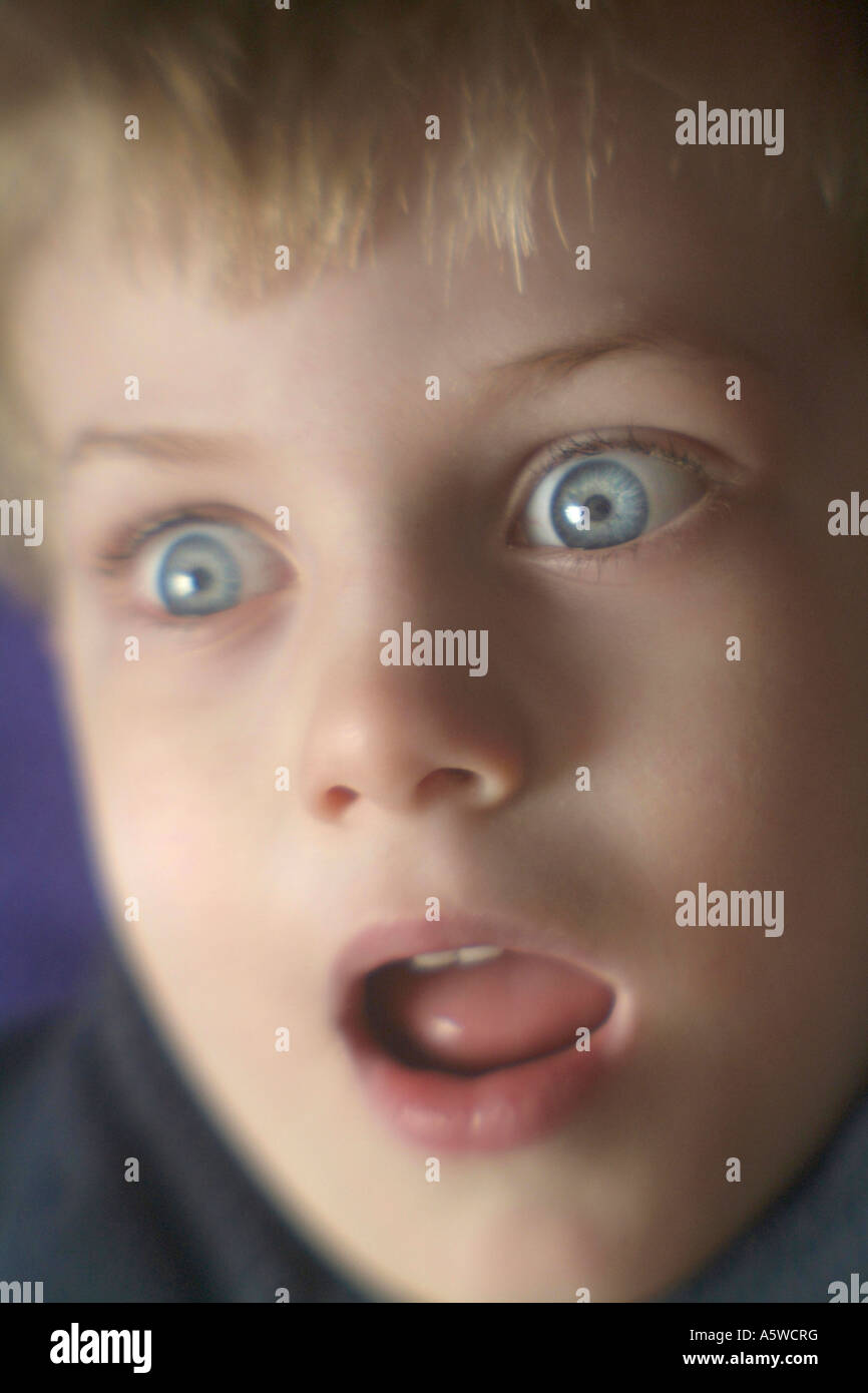 Boy with Amazed look on his face eyes wide open - Stock Image