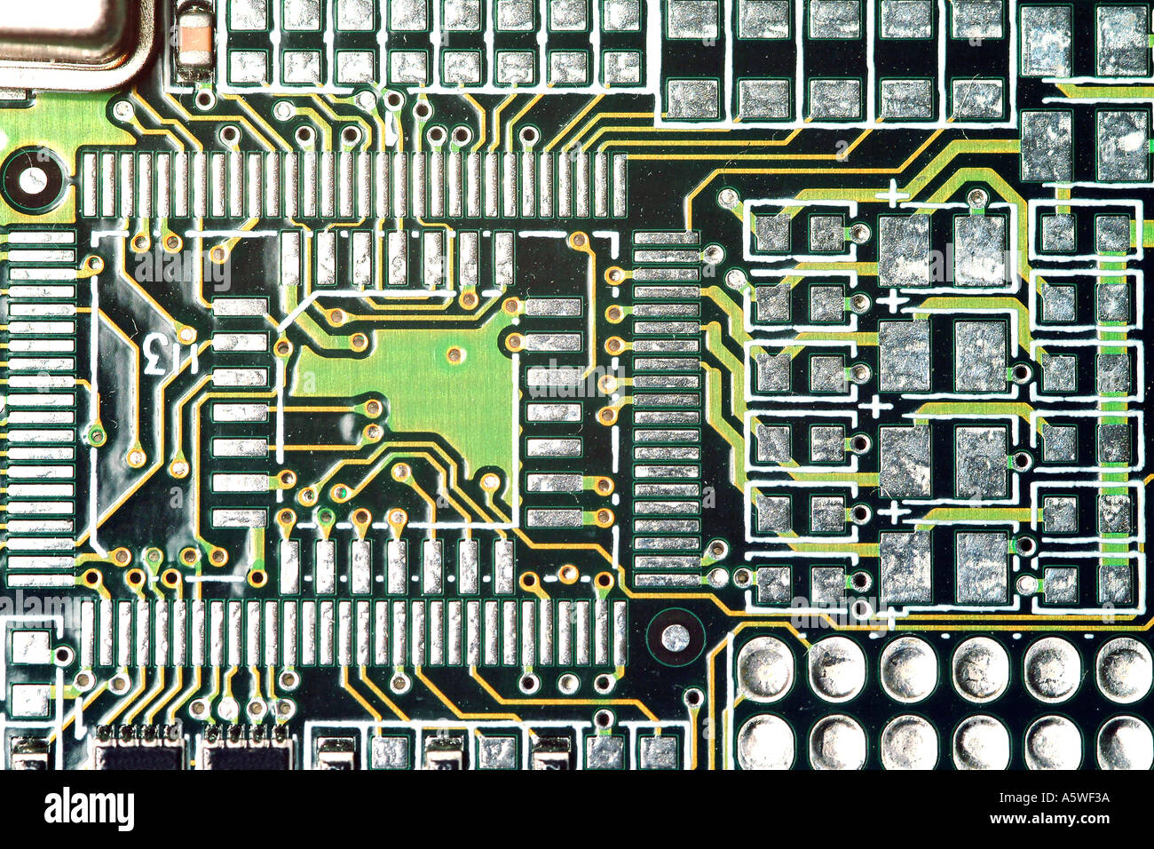 A close-up of the electrical circuitry on a computer graphics card ...