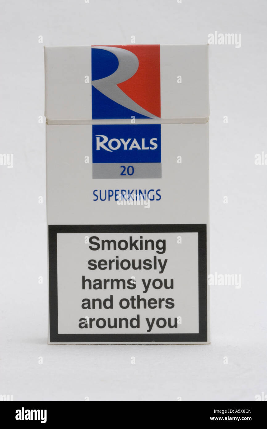 Red white and blue packet of Royals Superkings cigarettes with smoking seriously damages health warning UK - Stock Image
