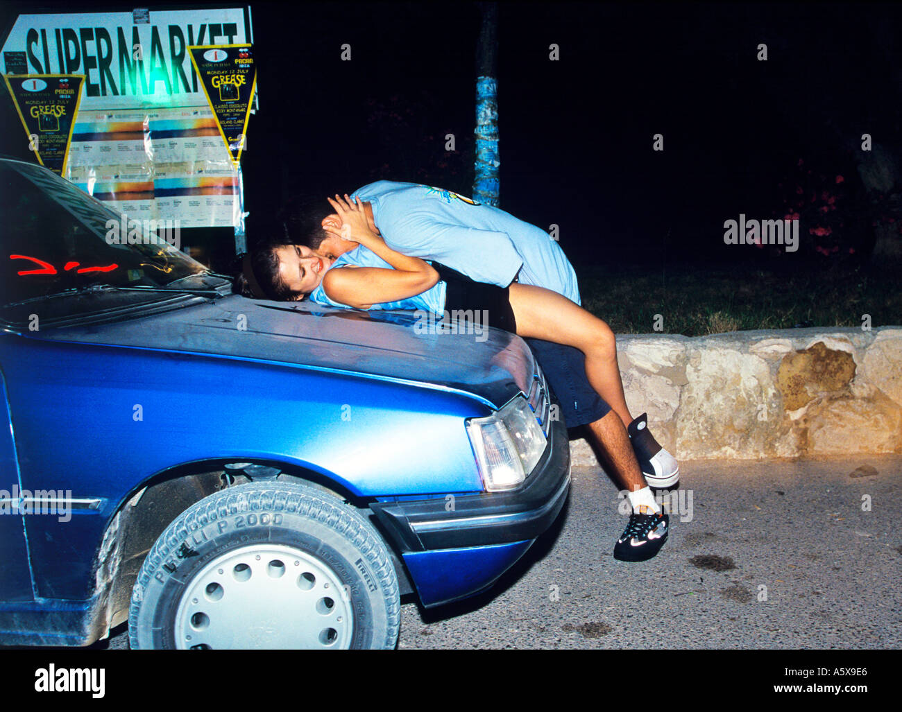 couple shagging on car bonnet outside space nightlcub in ibiza stock
