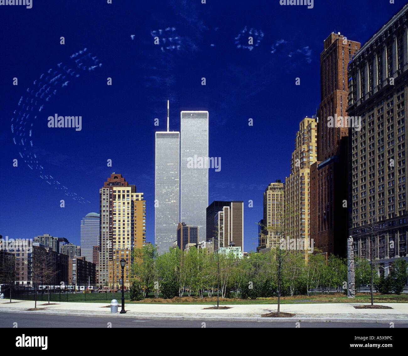 Look closely at skywriting forming a ring around the former World Trade Center twin towers in New York - Stock Image