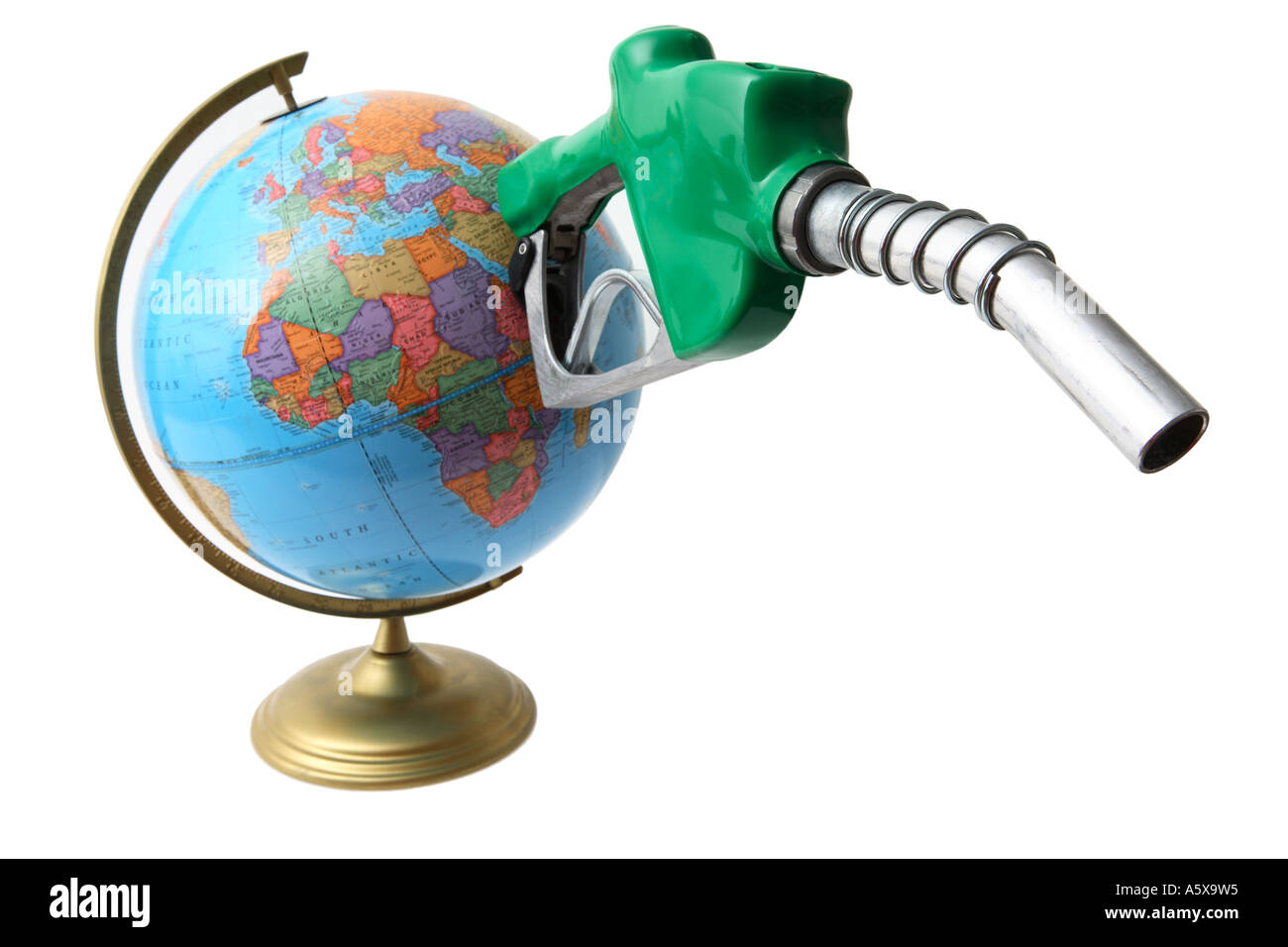 Globe with gas nozzle sticking out from Middle East area. - Stock Image