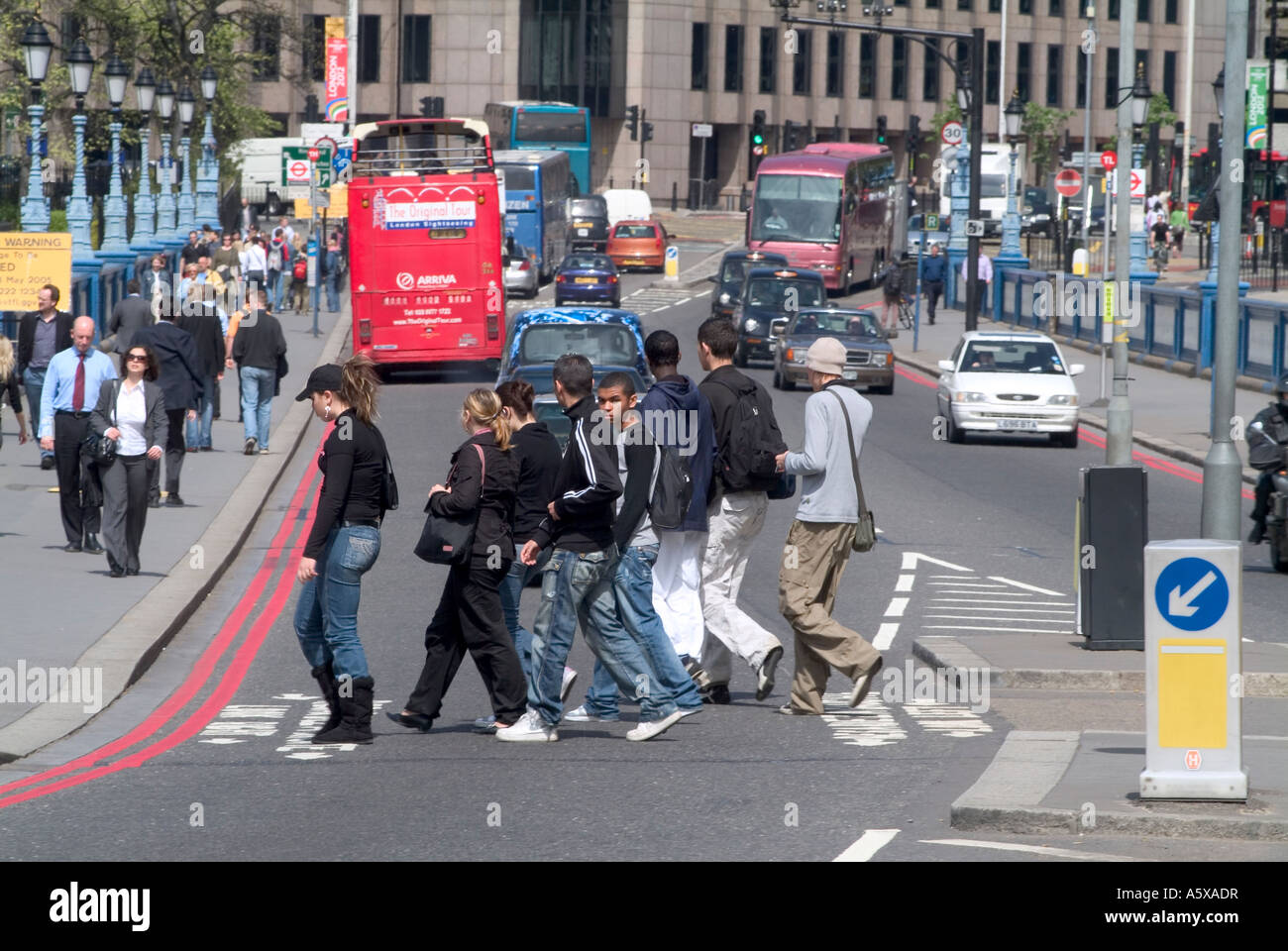 people crossing the road using a zebra crossing in the city of london, england Stock Photo