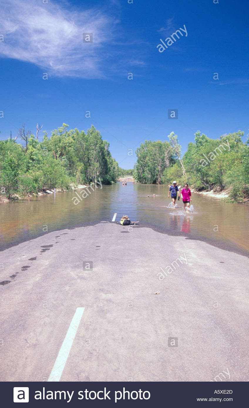 Wet season flood waters on a road in the Northern Territory Australia - Stock Image