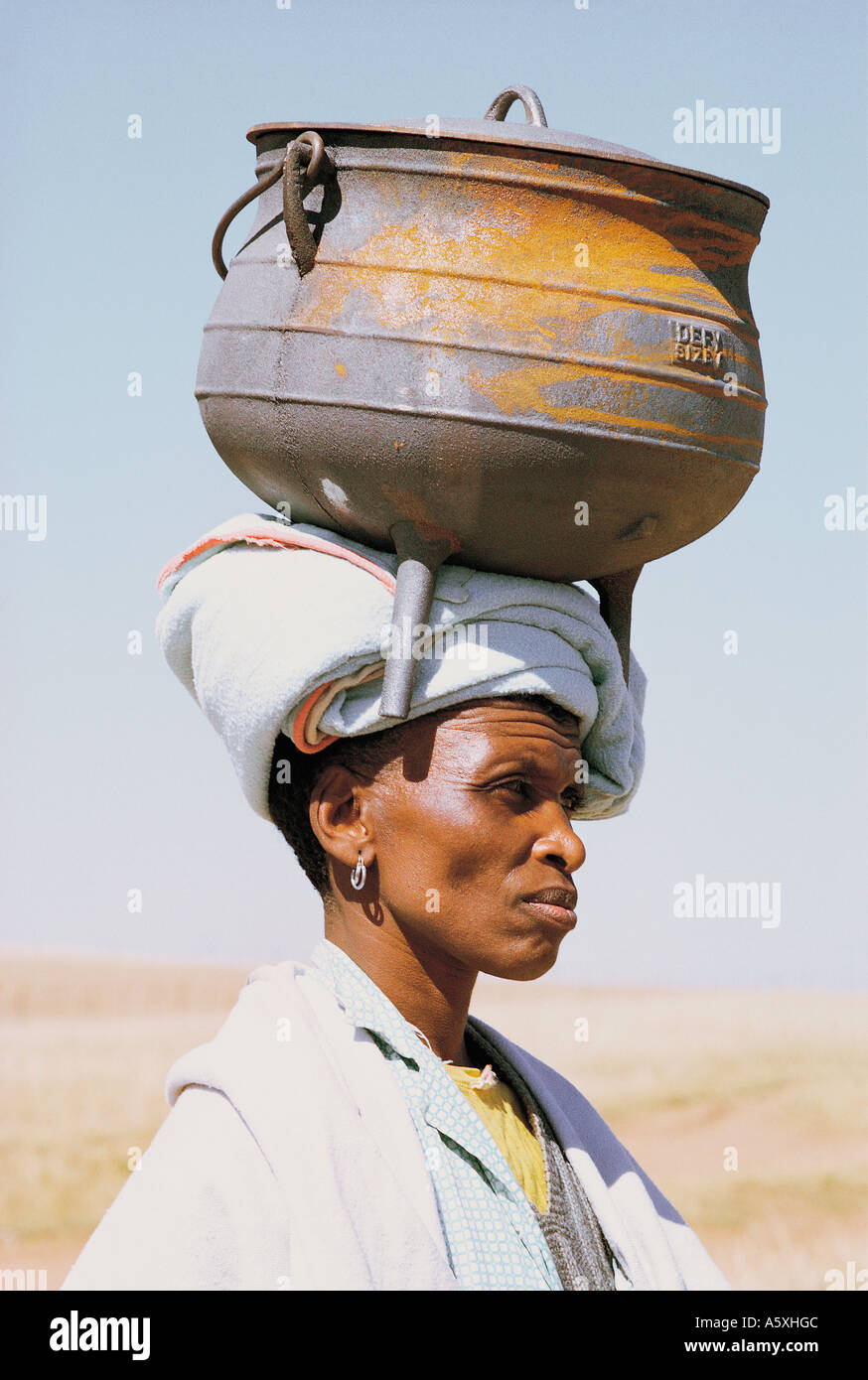 Xhosa Woman Carrying An Iron Cooking Pot On Her Head Natal