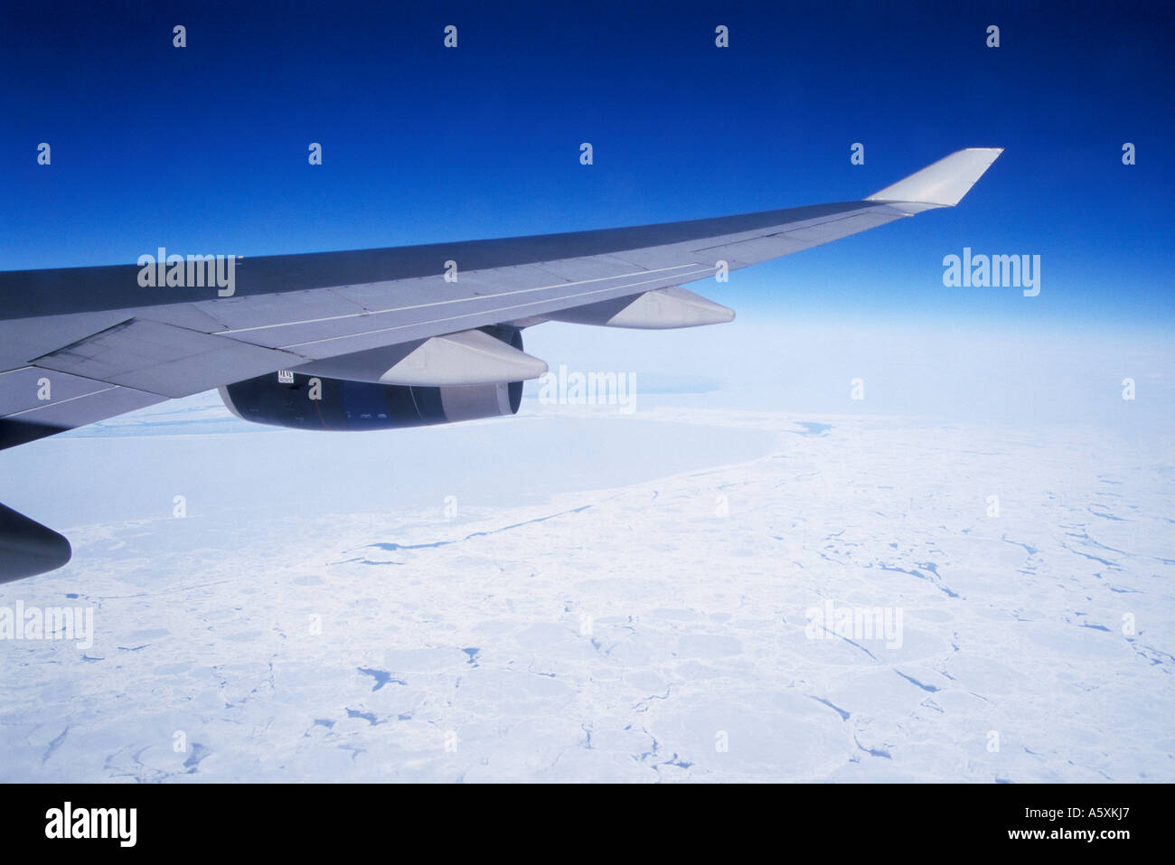 Aerial view of Airplane wing and of Ice bound Northern Canada Stock Photo