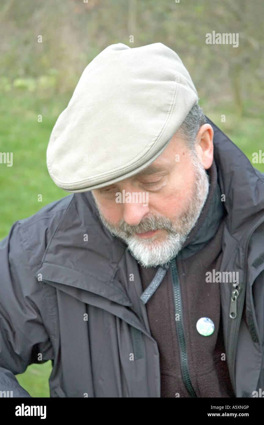 Man with beard in flat cap London Wetland Centre Barnes England UK ... 0598b543d0b