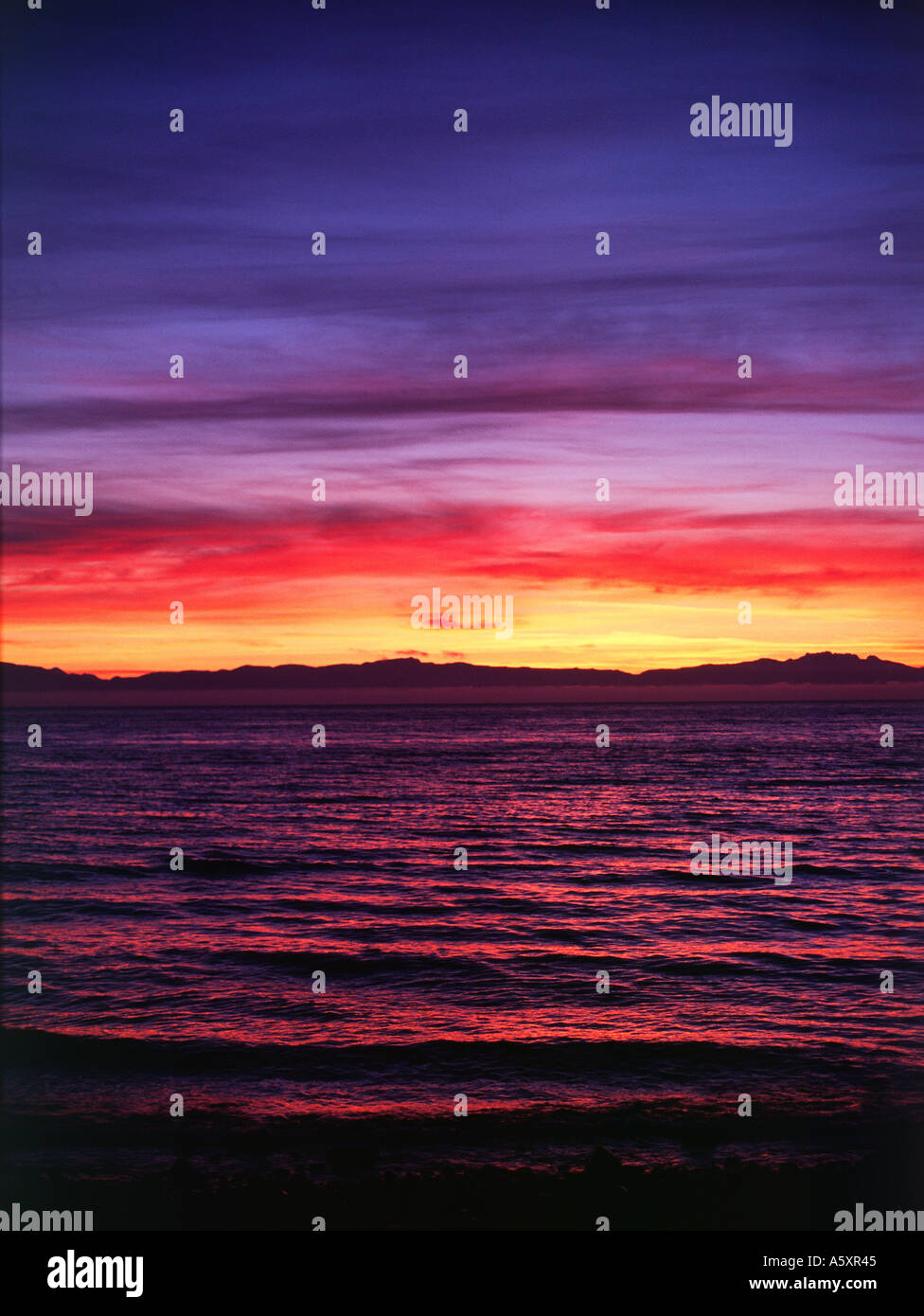 Davis Bay sunset with Vancouver Island in the distance. - Stock Image