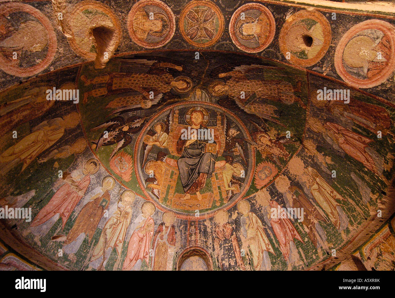 Ancient christian mural ceiling paintings in a troglodyte church in Cappadocia, near Goreme, Turkey. - Stock Image
