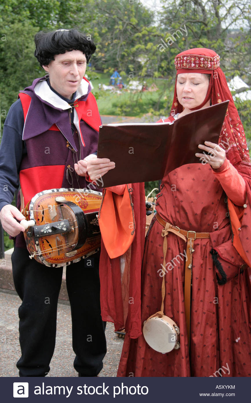 medieval street musicians singing and playing instruments - Stock Image