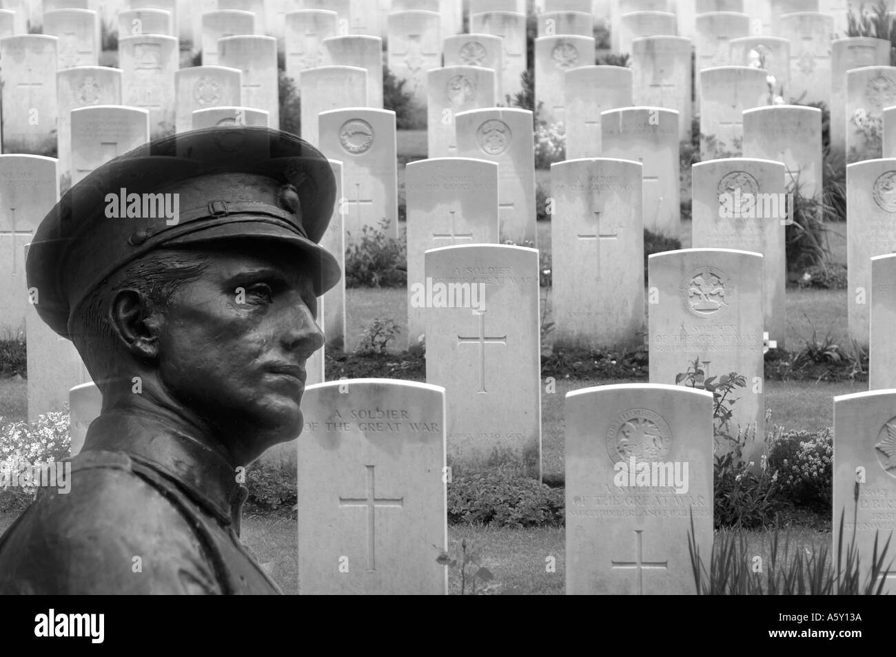 Juxtaposition of WW1 statue from London against Sanctuary Wood Military Cemetery in Belgium - Stock Image