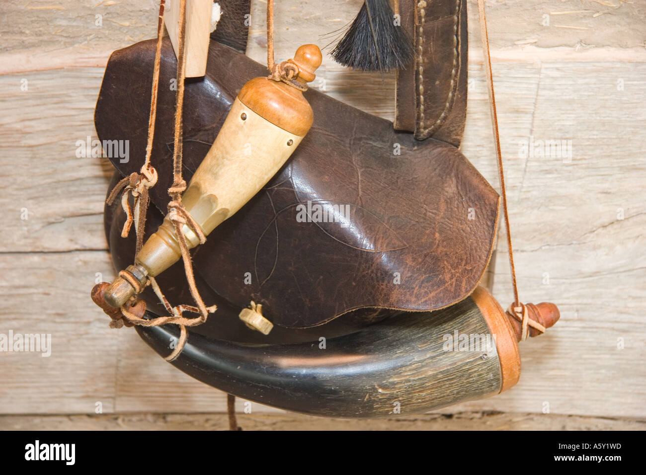 Pioneers 1800's Gunpowder Leather Pouch and Horn Hung on Cabin Wall - Stock Image