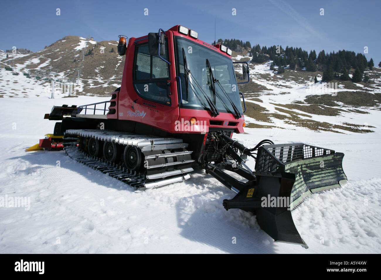 snow plough on piste, Kitzbuhel, Austria - Stock Image