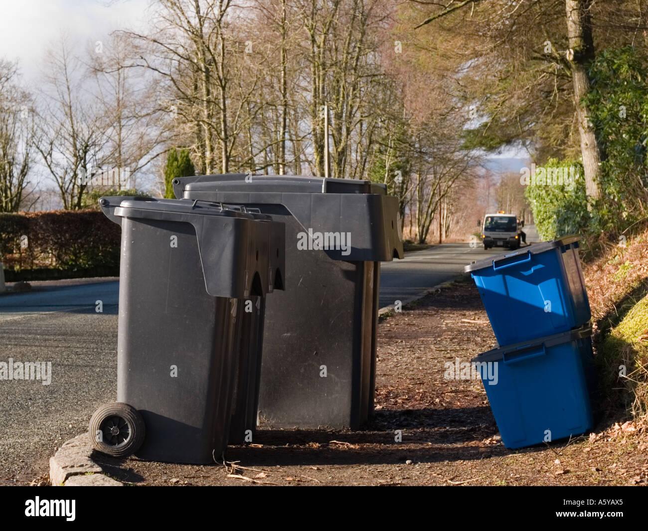 Kerbside re-cycling boxes beside 2 wheelie bins on roadside on bin collection day. Scotland UK Stock Photo