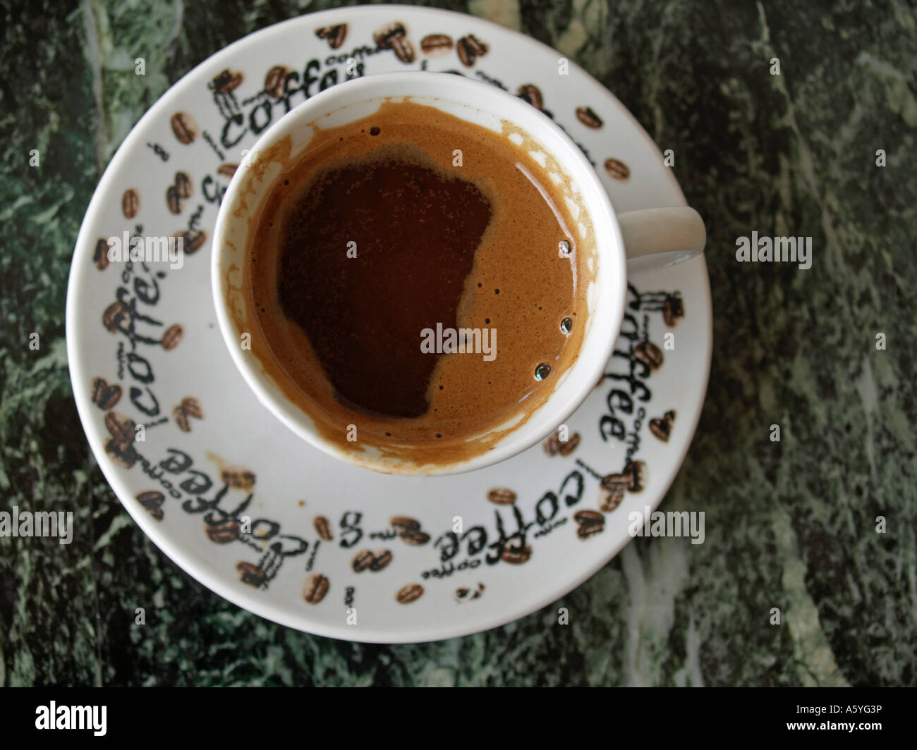 cup of coffee on a marmoreal marble table topview - Stock Image