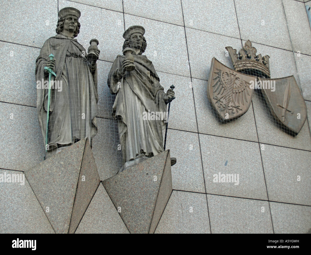stone figures patrons Cosmas and Damian and city arms on the wall of the town hall in Essen North Rhine Westphalia - Stock Image