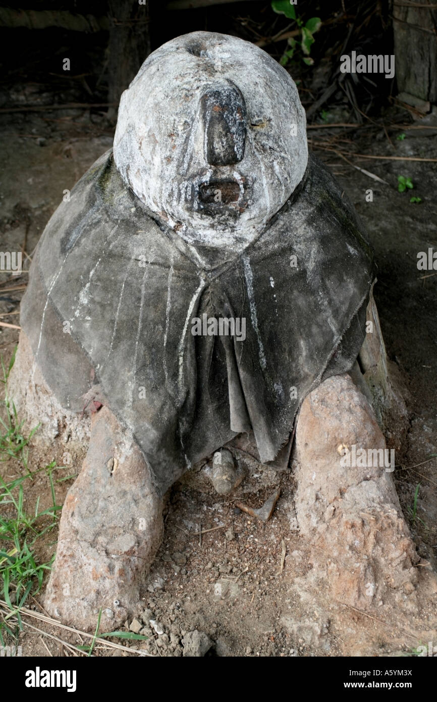 Voodoo Legba Statue near a lake to protect Fishermen , Benin, West Africa - Stock Image
