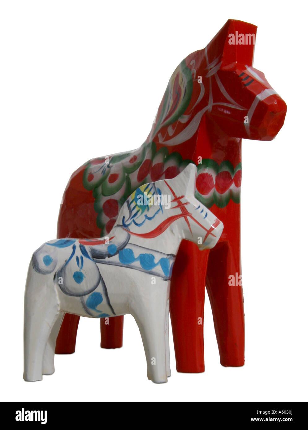 White and orange Dala horses - Stock Image