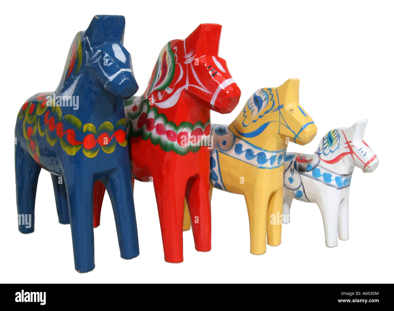 A herd of Dala horses blue orange yellow and white largest to smallest - Stock Image
