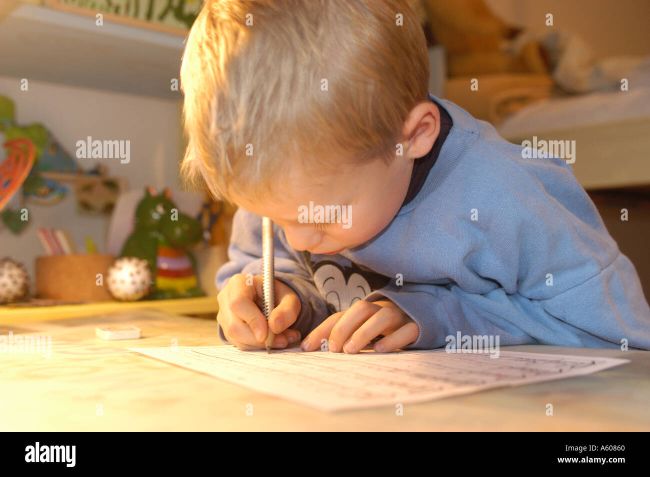Little boy doing his homework Stock Photo
