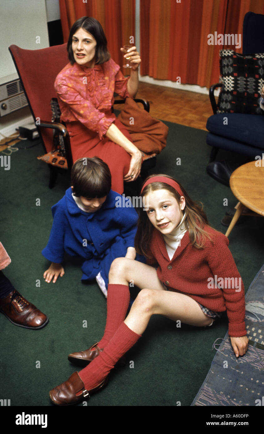 Historical shot of family lounging in their living room in the 1960's - Stock Image