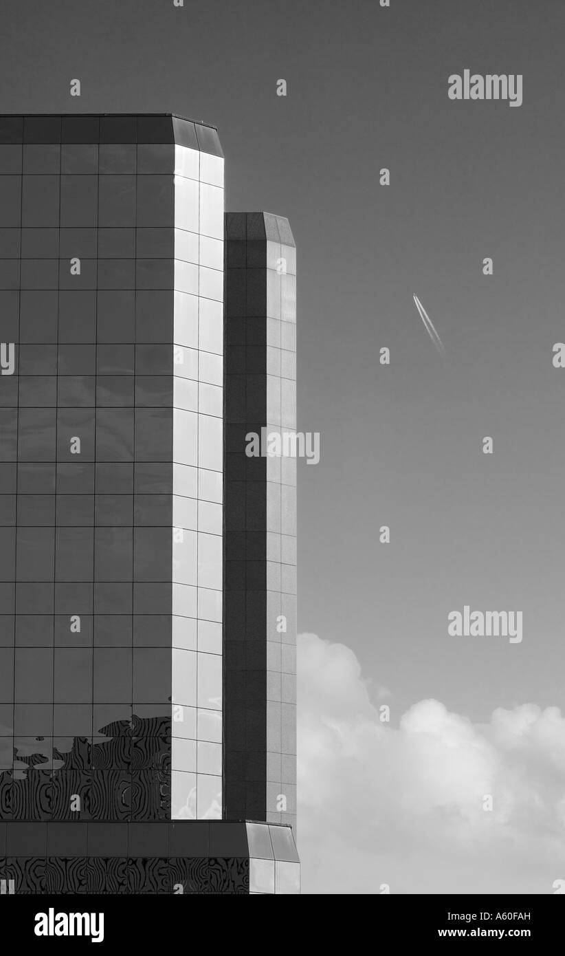 Modern Offices part of the Manchester skyline with aircraft UK in Black and White - Stock Image