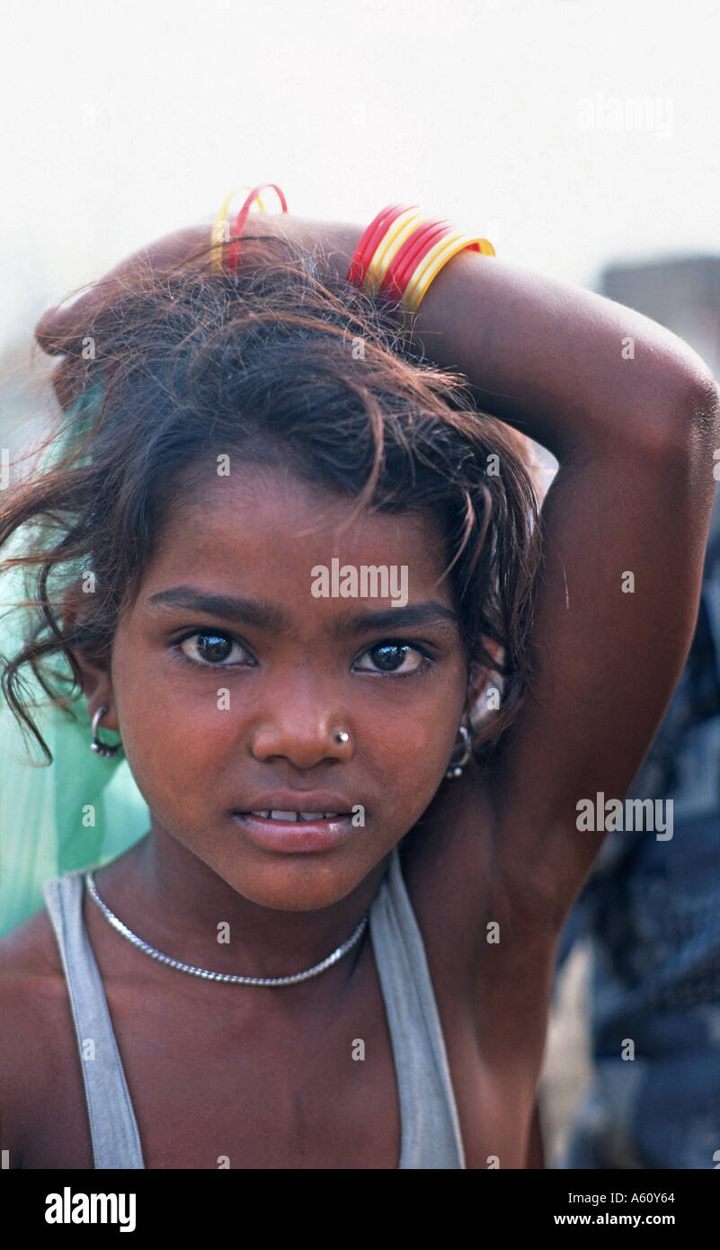 Young Indian girl carrying shopping at Agra s early morning vegetable market India - Stock Image