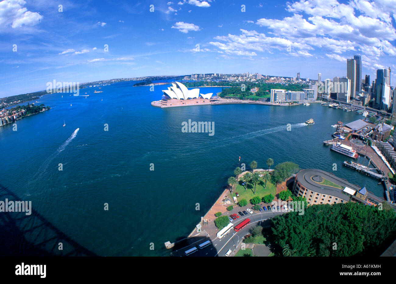 Beautiful Sydney Australia harbour and famous Opera House with skyline and downtown from airplane fisheye lens - Stock Image