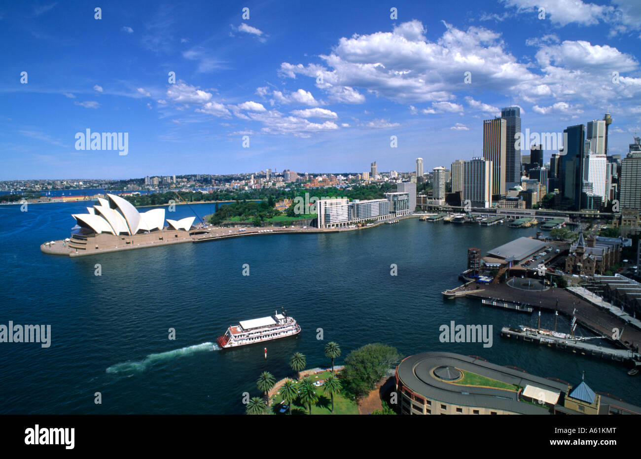 Beautiful Sydney Australia harbour and famous Opera House with skyline and downtown from aerial above - Stock Image