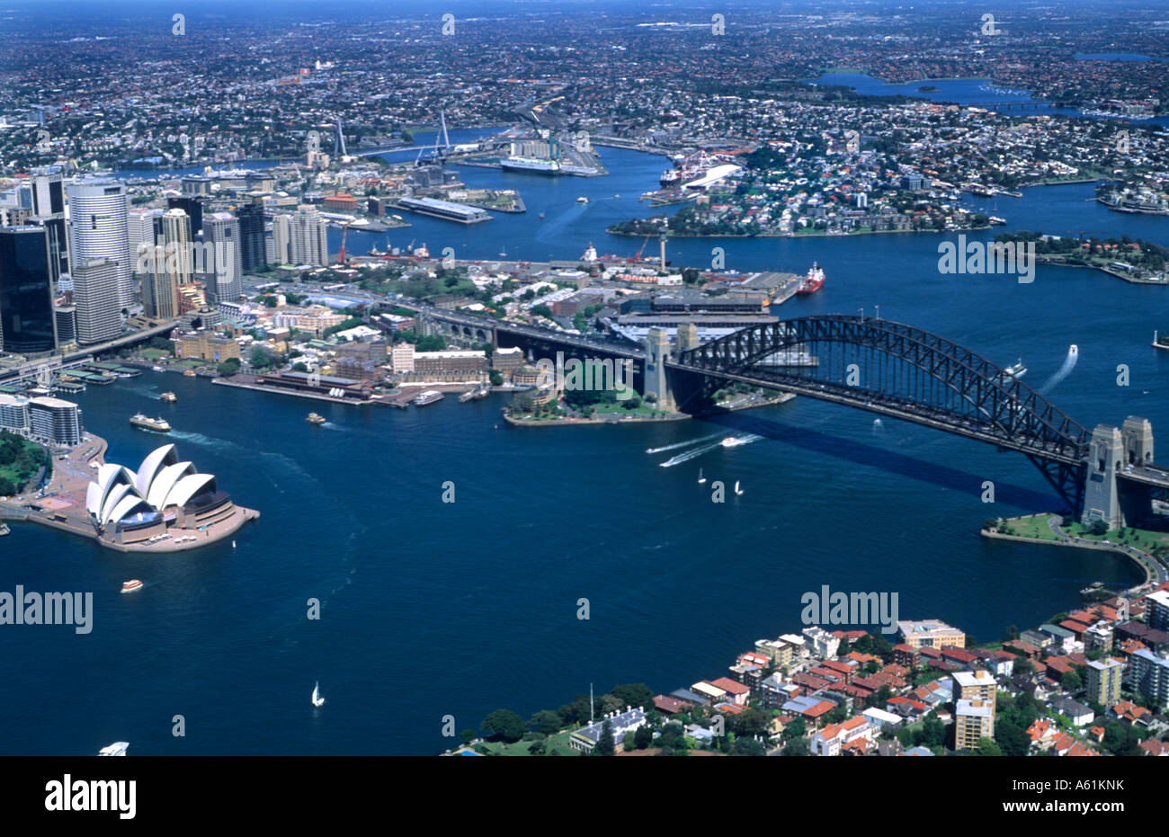 Beautiful Sydney Australia harbour and famous Opera House with skyline and downtown - Stock Image