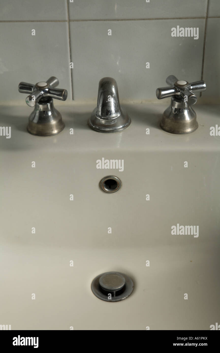 Old faucets in a toilette Stock Photo: 11432077 - Alamy