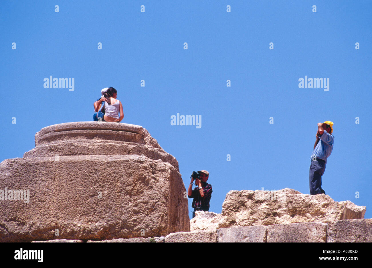 Low angle view of tourists photographing, Baalbek, Bekaa Valley, Lebanon - Stock Image