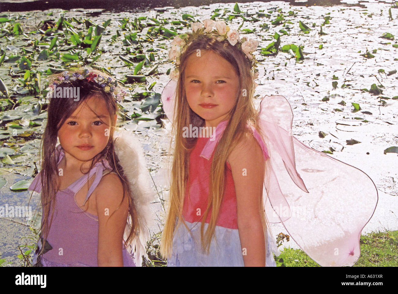two sisters by the lake - Stock Image