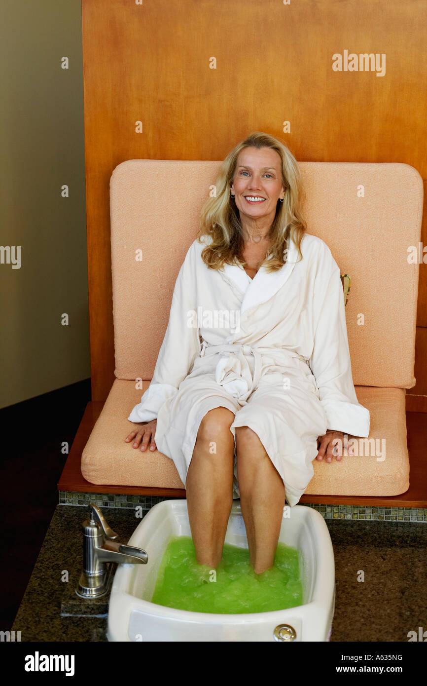 Portrait of a mature woman getting pedicure Stock Photo