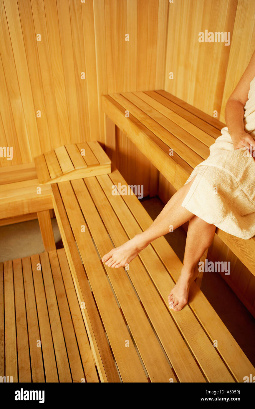 Low section view of a woman sitting in a sauna Stock Photo