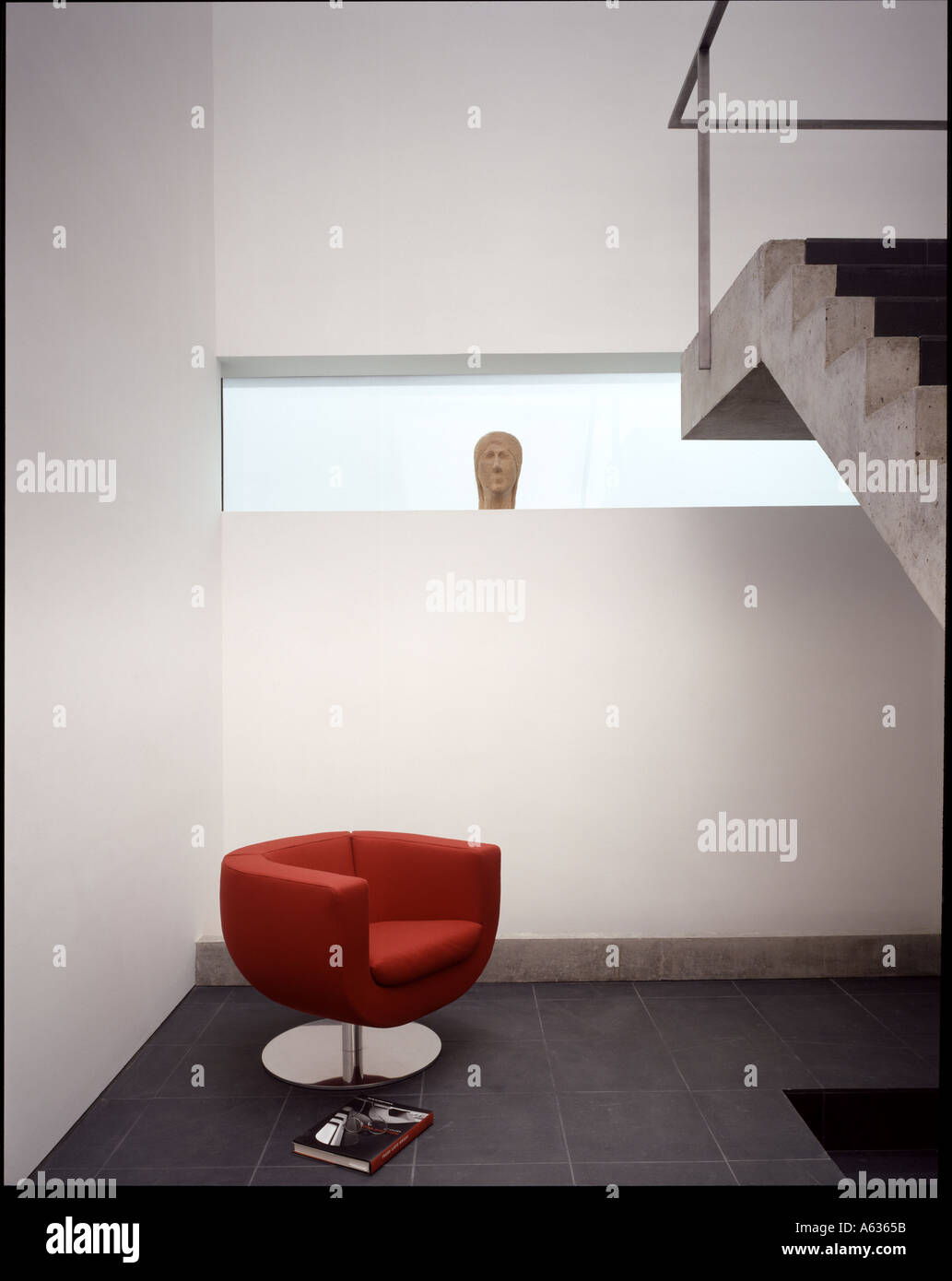 The Tall House Interior Of The Stair Well With Red Tulip Chair And Long  Window. Architect: Terry Pawson Architects