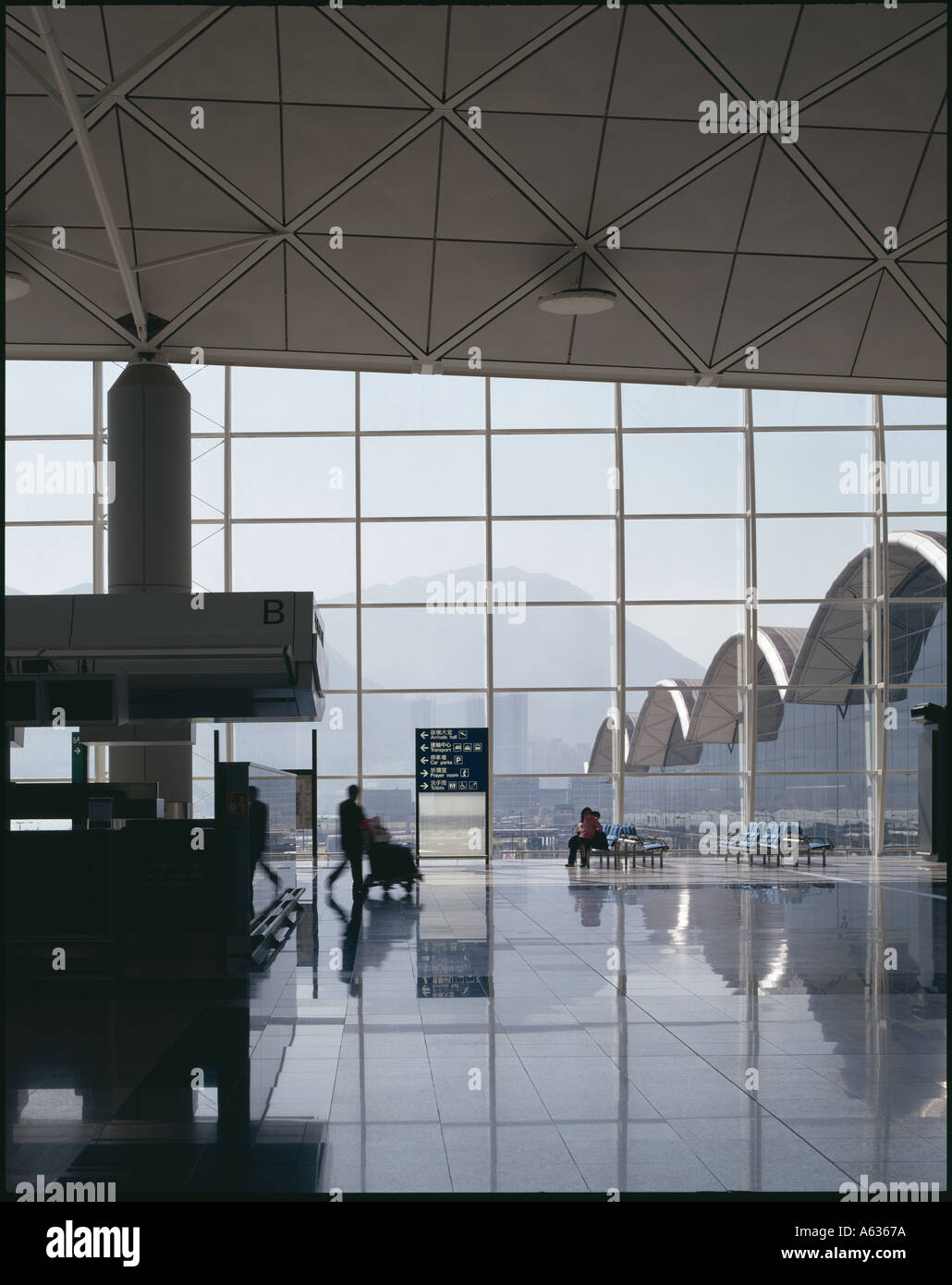 Hong Kong International Airport, Chek Lap Kok  Looking out from Check-in Area. Architect: Foster and Partners - Stock Image