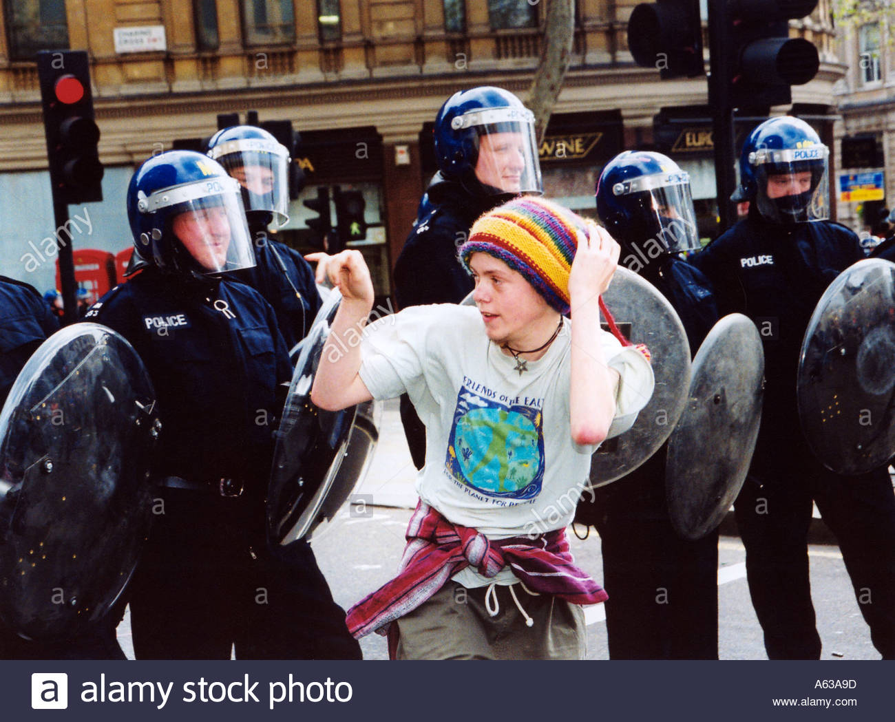 May Day anti capitalist demo Trafalgar Square London 1 May 2000 Young protester riot police UK - Stock Image