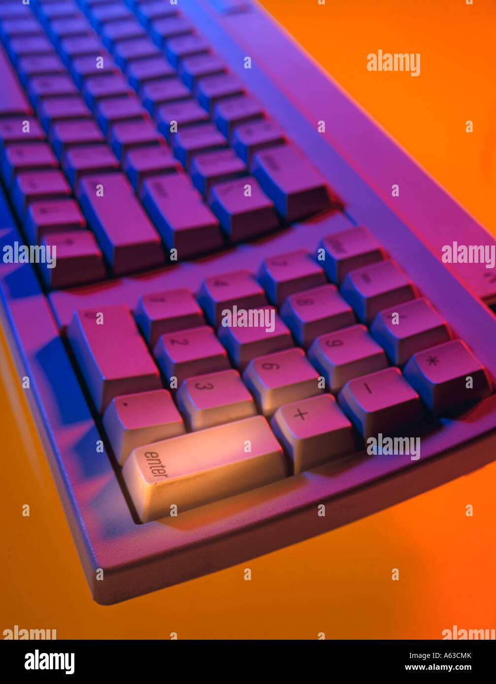 COMPUTER KEYBOARD WITH HIGHLIGHT ON ENTER KEY - Stock Image