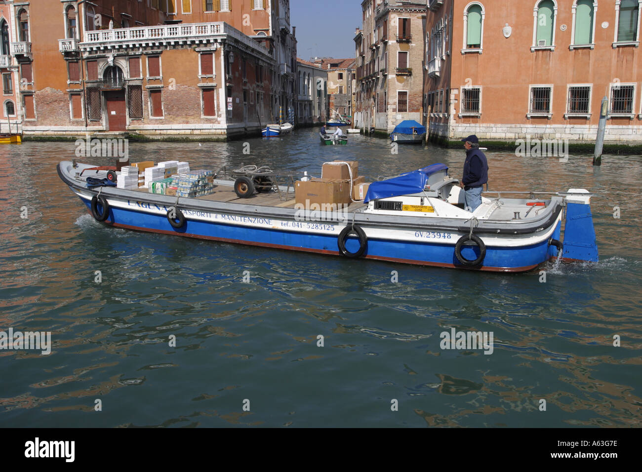 Topo barge product delivery service on the Grand Canal Venice Italy - Stock Image