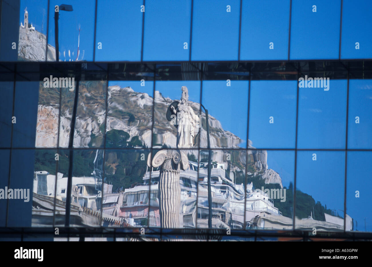 The statue of Athena and of Lykavittos Hill reflected in glass on Panepistimiou, Athens, Greece - Stock Image