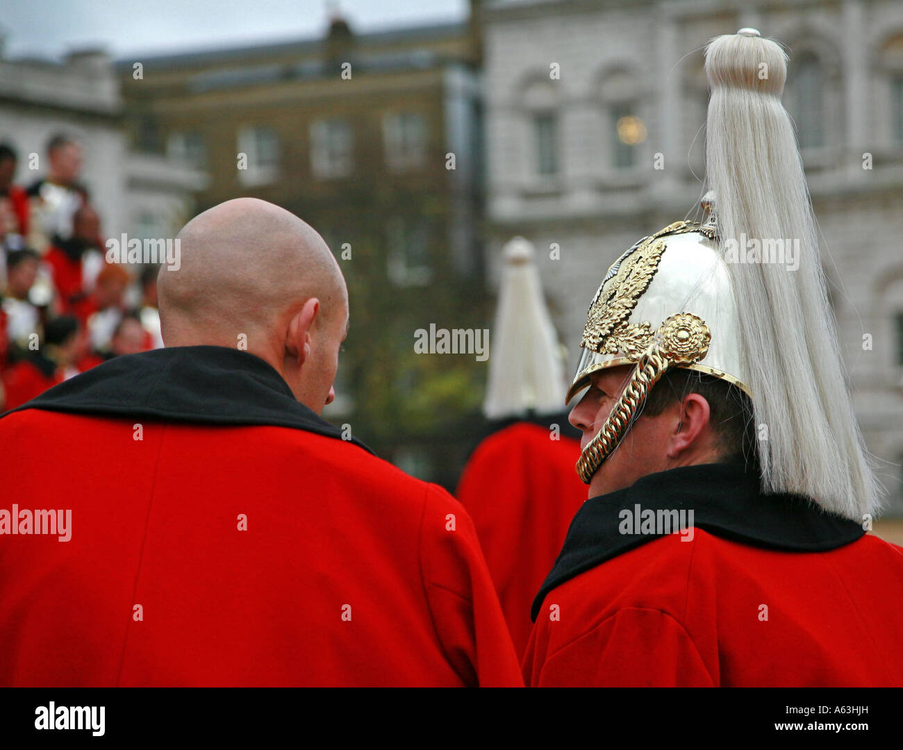 Two soldiers of the Household Cavalry enjoy a chat at a gathering on Horse Guard's Parade London - Stock Image