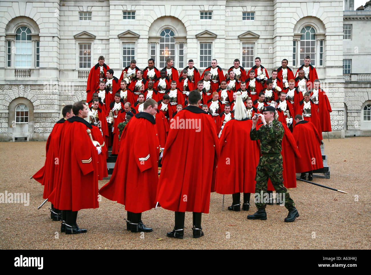 Household Cavalry  line up for a group photograph in Horse Guards Parade London - Stock Image