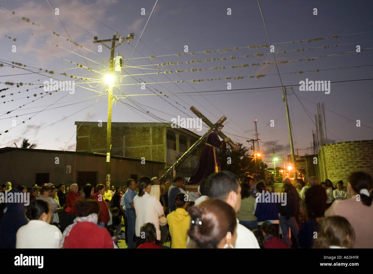 First Friday of Lent parade through streets with Jesus on crucifix Esteli Nicaragua - Stock Image