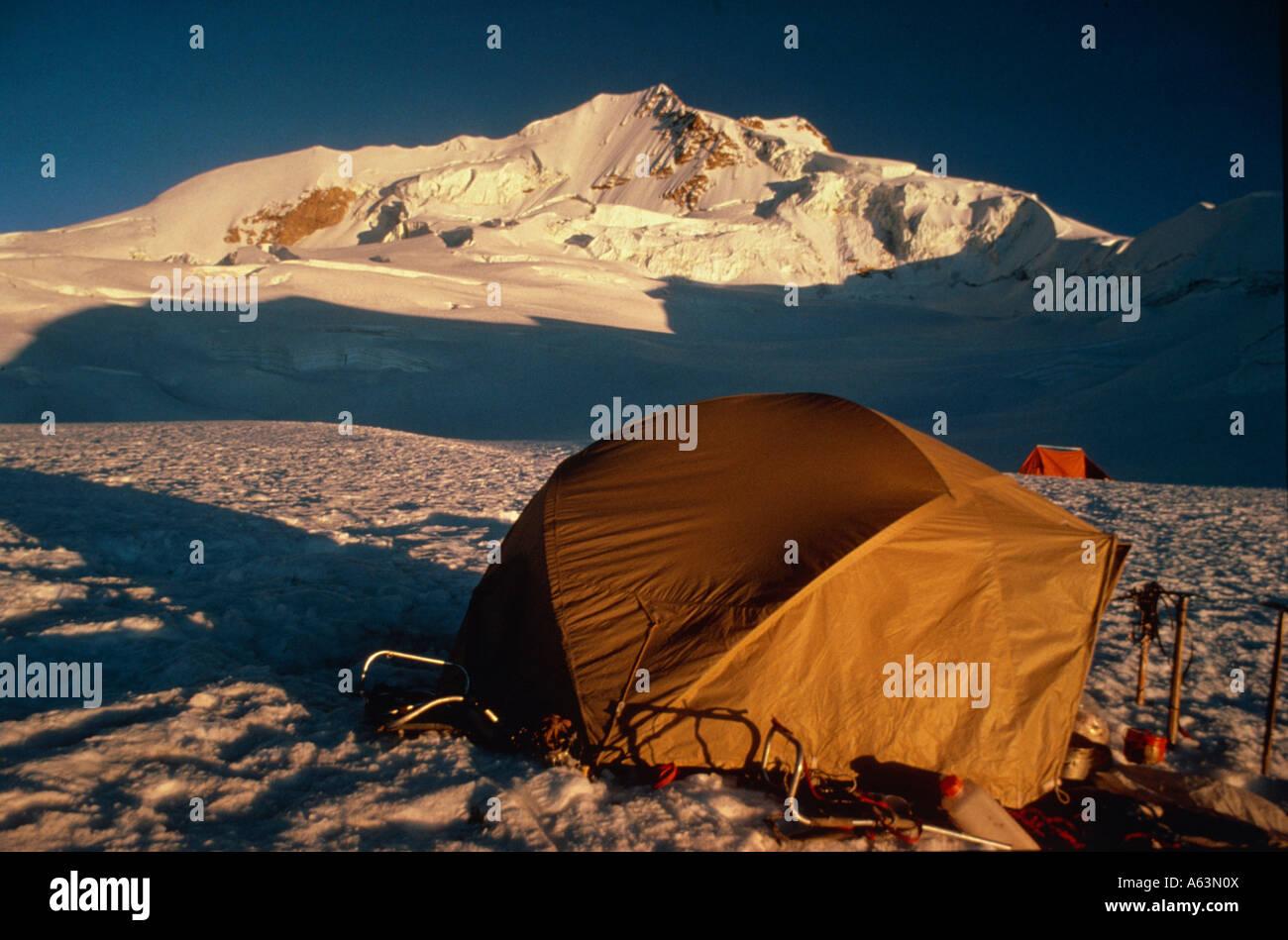 bivouacing on snowfield at evening mountain range of cordillera real bolivia - Stock Image
