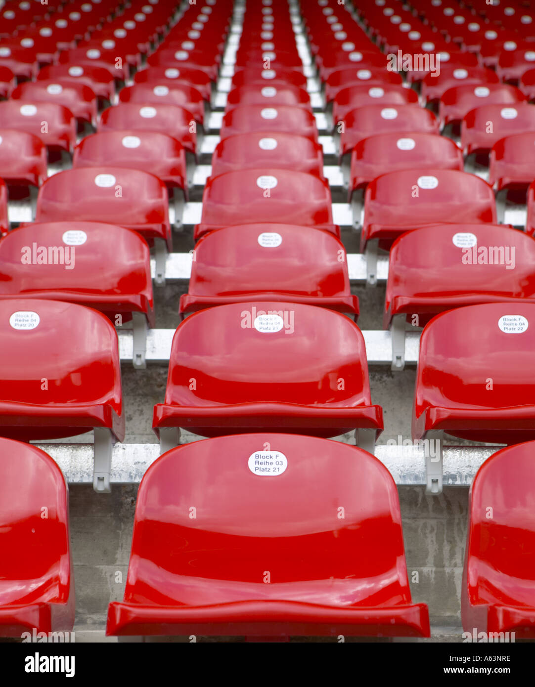 Low angle view of empty chairs at football stadium - Stock Image
