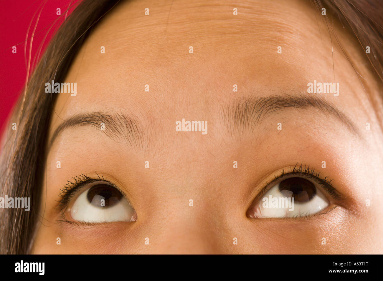 Asian woman's eyes looking up - Stock Image
