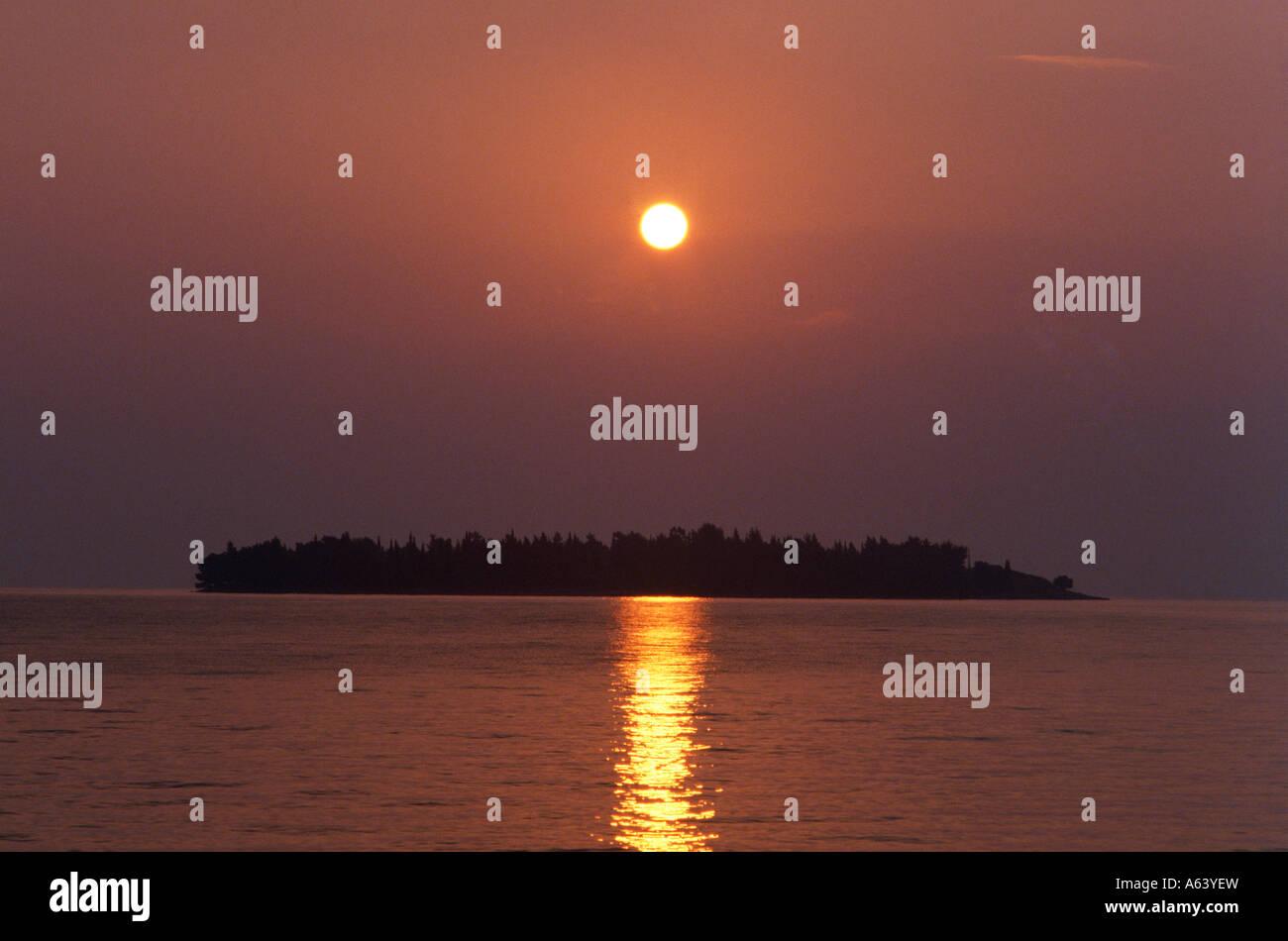 islet at sunset near island of corfu ionian islands greece - Stock Image