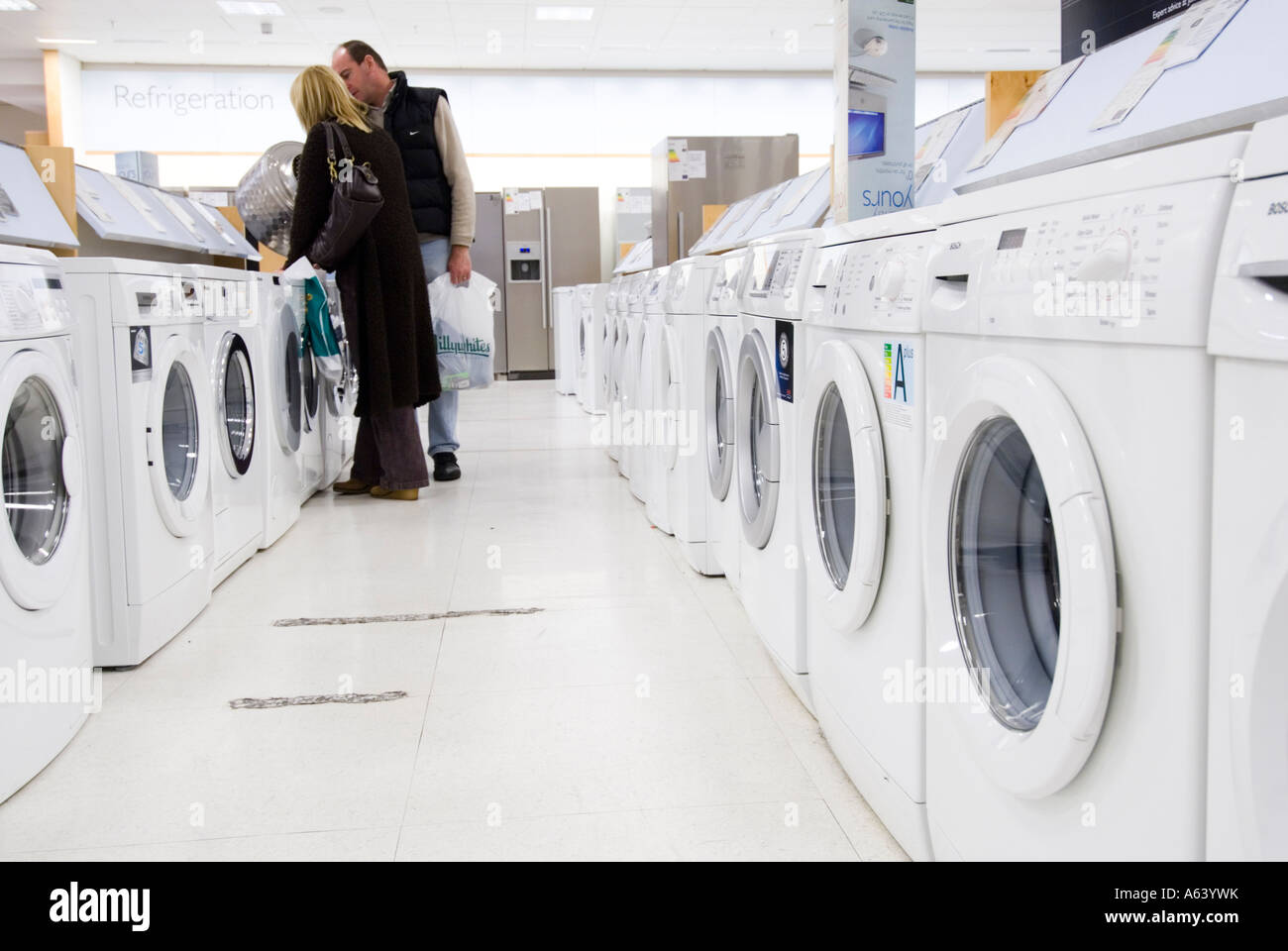 c92df04a4df Couple looking at new washing machines in John Lewis London England ...